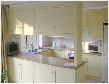 kitchen with flyover cabinets in sixties built town house, built and installed by Celtica Kitchens